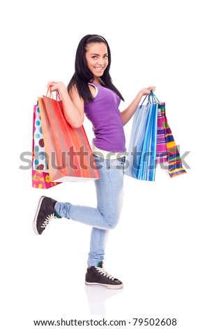 happy shopping girl holding color bags, isolated on white background - stock photo