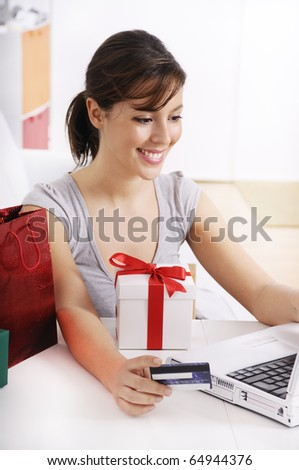 happy shopping on-line of young woman with laptop on internet - stock photo