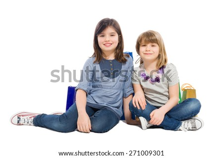 Happy shopping sisters or daughters smiling isolated on white background
