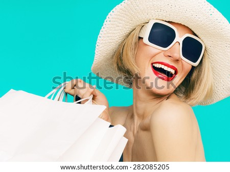 Happy Shopping Summer Lady on blue background - stock photo