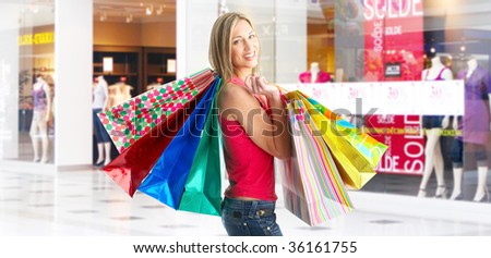 Happy shopping  woman at the mall - stock photo