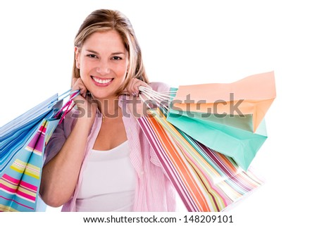 Happy shopping woman holding bags - isolated over a white background  - stock photo
