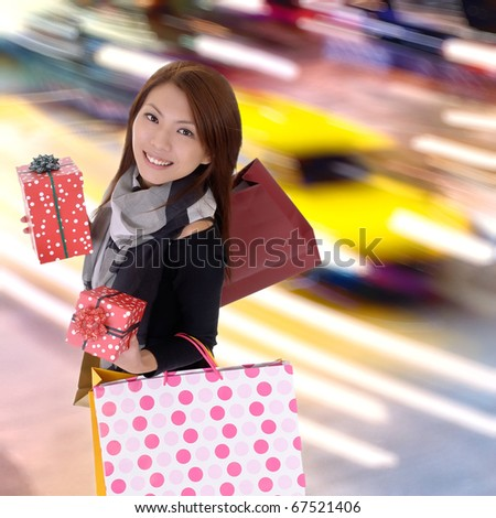 Happy shopping woman in modern colorful city night with cars motion blurred. - stock photo