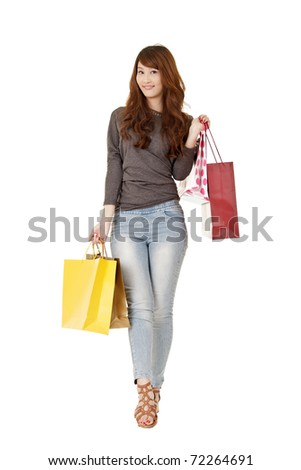 Happy shopping woman of Asian holding bags, isolated on white background.