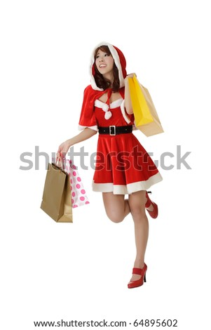 Happy shopping woman walking in Santa Claus clothes isolated over white. - stock photo