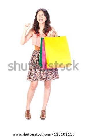 Happy shopping woman with bags