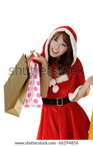 Happy shopping woman with bags in Santa Claus clothes. - stock photo