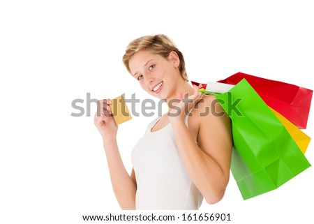 happy shopping woman with credit card and shopping bags on white background - stock photo
