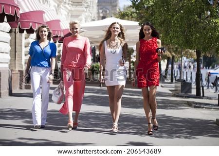 Happy shopping women walking at the mall  - stock photo