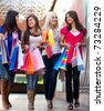 Happy shopping women walking at the mall and smiling - stock photo