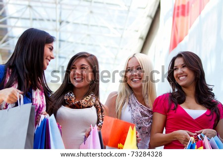 Happy shopping women with bags and smiling - stock photo