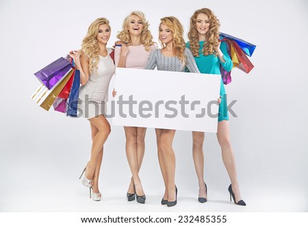 Happy shopping women with empty board