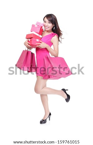 happy shopping young woman running with bags and gift box - isolated on white background, full body, asian model - stock photo