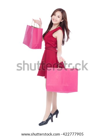 happy shopping young woman show bags - isolated on white background, full body, asian beauty - stock photo