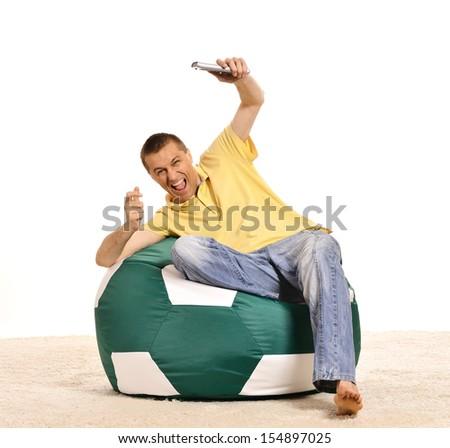 Happy shouting man watching football on tv - stock photo