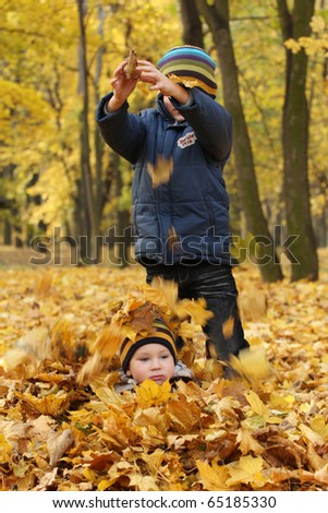 Happy sibling in park. - stock photo