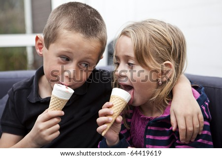 Happy Siblings eating ice-cream - stock photo