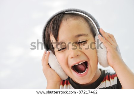 Happy singing boy - stock photo