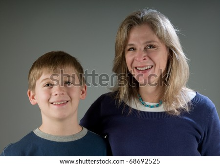Happy single mom with her ten year old son - stock photo