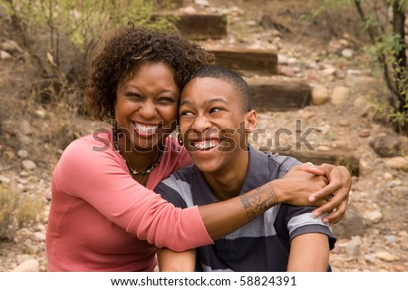 Happy single-mother and teen son - stock photo