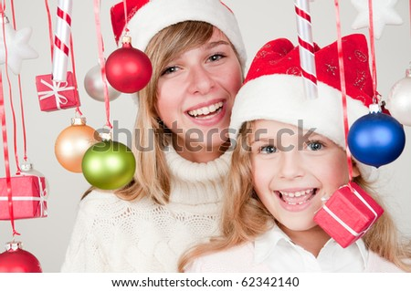 Happy sisters at Christmas time - stock photo