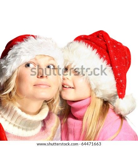 Happy sisters in Christmas hat isolated on white backround. - stock photo
