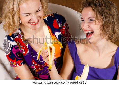 happy sisters in laugh wtth bananas