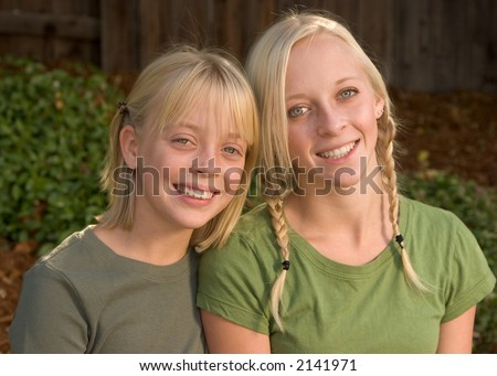 Happy Sisters in Outdoor Location