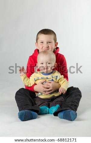 happy sitting siblings - stock photo