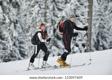 happy  ski people at mountaint  on winter have fun on snow sports - stock photo