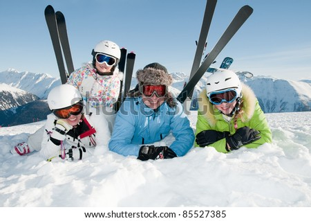 Happy ski vacation - skiers portrait