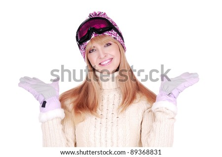 Happy skier woman in hat and ski goggles