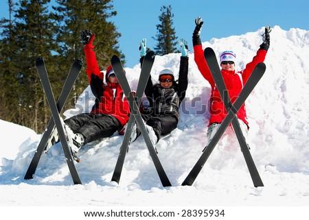 Happy skiers resting on ski resort - stock photo