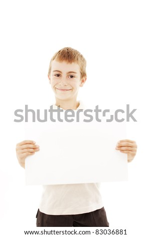 Happy small boy holding a blank board on white - stock photo