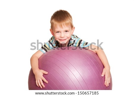 Happy small boy with the fitness ball. A healthy lifestyle since the childhood. Isolated on white background - stock photo