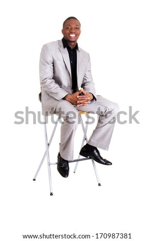 Happy smart black businessman smiling, isolated on white. - stock photo