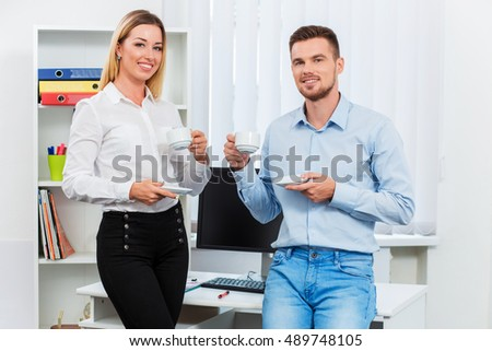 Happy smart business couple discussing