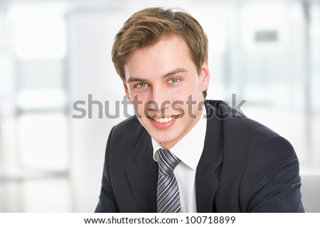 Happy smart young business man - stock photo