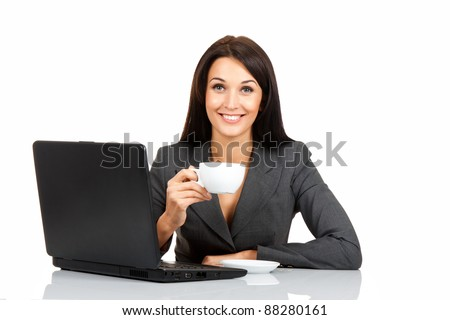 happy smile business woman hold cup of coffee sitting at the desk with laptop, isolated over white background - stock photo