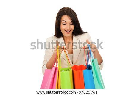 Happy smile business woman holding colorful shopping bags look into isolated over white background