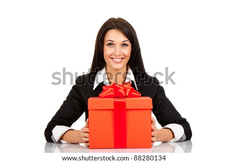 happy smile business woman red gift box with bow sitting at the desk, isolated over white background - stock photo