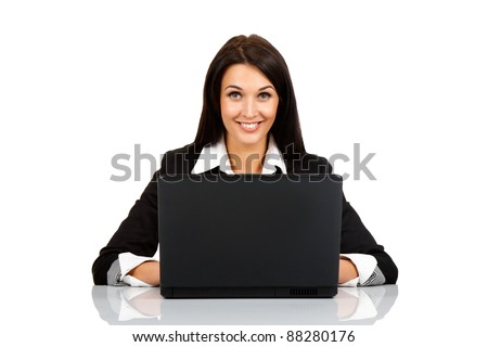 happy smile business woman sitting at the desk looking at camera, using laptop, isolated over white background, concept of businesswoman with success - stock photo