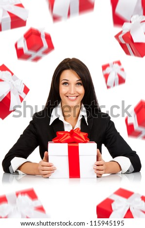 happy smile business woman white gift box with red bow sitting at the desk, present fall fly around, isolated over white background - stock photo