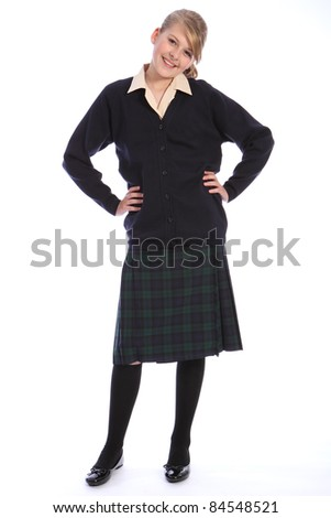 Happy smile from beautiful teenage high school student girl wearing school uniform, tartan skirt and beige shirt with navy cardigan. - stock photo