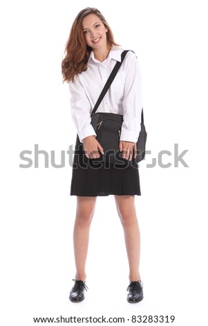 Happy smile from beautiful teenage secondary school student girl wearing black and white school uniform, holding on to her bag. - stock photo