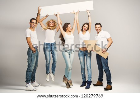 Happy smile group of young people holding a blank white card board - stock photo