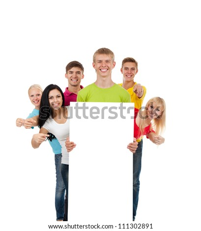 Happy smile group of young people holding a blank white card board, signboard, point finger show empty bill board Isolated over white background