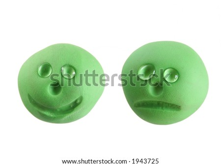 Happy smiley and sad smiley with tears - stock photo