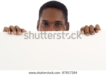 Happy smiling African American man holding a banner ad, sign showing only his eyes isolated over white background