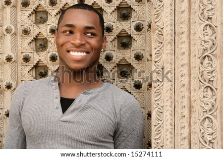 Happy Smiling African American Young Man Outdoors - stock photo